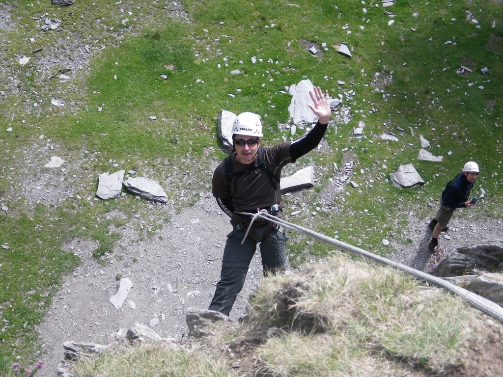 Abseil with hand wave Lake District