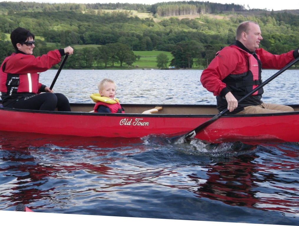 Family canoeing coniston water