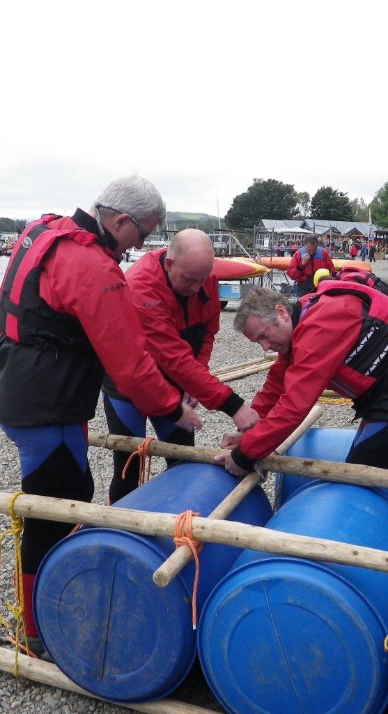 Team building a raft